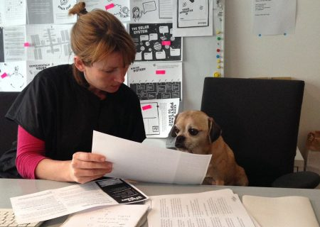 Kristen Harrison and Sam the Dog working on the second edition of Principia Space Diary